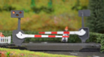 TTLCN10P Brand: Train Tech Scale: 1:148, N  Level Crossing Barrier Set With Light & Sound (N) Pair